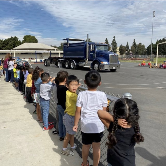 Students lined up to watch a truck show how it works!